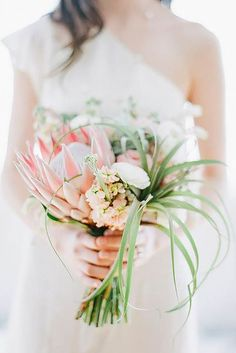 39 Beautiful Wedding Bouquets That Are Unique ♥ Try to incorporate into beautiful wedding bouquets exotic protea, colorful kale flowers, great combination of pine cones and cotton. #wedding #bride #weddingforward #weddingbouquets Tropical Wedding Bouquets, Protea Wedding, White Wedding Bouquets, Bridesmaid Bouquet, Floral Wedding, Wedding Flowers, Wedding Bride, Bridal Bouquets, Tropical Flowers