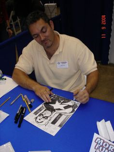 Ron Garney (here seen drawing Captain America in a Baltimore Comic con event) is the new Thor comic book artist (since Thor God of Thunder #13, released on September 2013)
