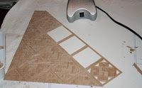 Start in the middle of the square.                Cut the veneer that makes it easier when you want to work at the parquet.      Sti...