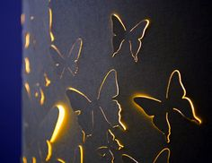 This is a lamp shade that comes in multiple colors.  It creates a nice silhouette around the butterflies.