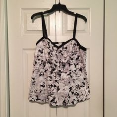 Black and white floral top Cute black and white floral print top. Worn once. Still in great condition. Size 0 torrid Tops Blouses