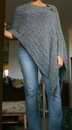 Loose Crochet Poncho.                                                                                                                                                     More