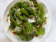 Chef Way For this crunchy, nutty salad, Lidia Bastianich likes to use dandelion greens, which aren't always easy to find.Easy Way Arugula stands in for the elusive dandelion greens. More Green Salads Healthy Salad Recipes, Veggie Recipes, Wine Recipes, Lidia Bastianich, Easy Thanksgiving Recipes, Thanksgiving Side Dishes, Italian Dishes, Italian Recipes, Italian Meals