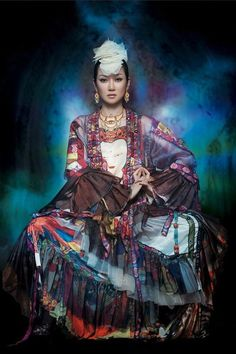 Sa Ding Ding..... Have only just heard of her, she is a Chinese folk singer.  She is absolutely gorgeous to boot!