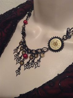 Steampunk Drop style Necklace with Black clock by WirednStrung