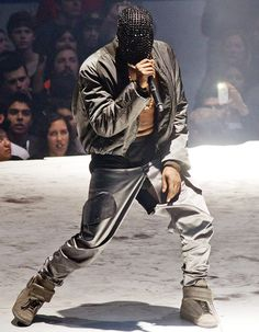 Kanye West performing in Seattle wearing Mask...Rips his pants too!!!!...hahahaa!!!.. #FashionCrimes..SMH!
