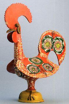 Uma história natural do Galo de Barcelos. Galo Moderno ainda com algumas características arcaicas (a forma do pedestal e a representação das patas)