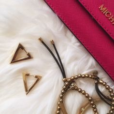 Metal Triangle Gold Earrings Gold triangle earrings, brand new in packaging. Material Content: Metal Alloy Adia Kibur Jewelry Earrings