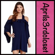 "Boho TUNIC DRESS Cold Shoulders BOHO TUNIC DRESS  New With Tags   * Scoop neck, thick straps, & off the shoulder  * Long bell sleeves * Ruffled front & back yoke  * Relaxed fit * About 35"" long * 95% Polyester & 5% Spandex  * Color: Navy Blue * Tagged XS but it is an oversized style that best fits sizes 4-6 (S), thus it is listed accordingly.  No Trades ✅ Offers Considered*/Bundle Discounts✅ *Please use the blue 'offer' button to submit an offer. 93500 Boutique Tops Tunics"