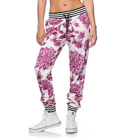 Step up your style game in these thick terry joggers that feature a lush floral print throughout that is contrasted by a striped elastic waist band and ankle cuffs.