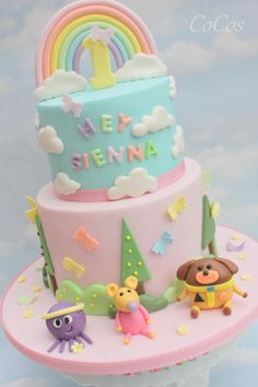 A Hey Duggee themed tiered cake with added fondant rainbows and butterflies for a little girl turning 1 3rd Birthday Cakes For Girls, 1st Birthday Cake For Girls, Baby Birthday Cakes, Birthday Ideas, 1st Year Cake, Easter Bunny Cake, Girl Cakes, Dessert, Fondant Rainbow