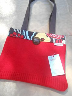 Red tote bag with vintage Bakelite button and fun Alexander Henry floral print lining.