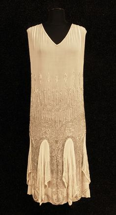 BEADED FLAPPER DRESS, Cream silk chiffon w/ silver and white beading creating a series of arches on the skirt having full chiffon gores w/ handkerchief points and bead decoration. 20s Fashion, Fashion History, Vintage Fashion, Flapper Fashion, Classic Fashion, Vintage Style, High Fashion, 20s Dresses, Vintage Dresses