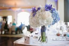 simple glass vases with small bouquet as centrepieces