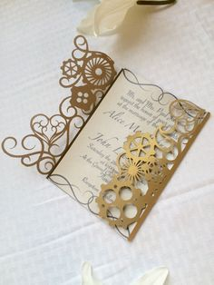 This is an amazing cut paper steampunk wedding invitation. This unique cut paper pattern is cut so that the gears and hearts are surrounded by