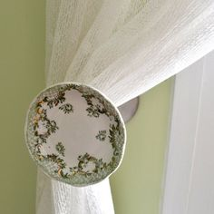 "A neat idea you can buy and probably make.  A  recycled china butter pat dish is transformed into a unique drapery holdback for your home. The small 3"" plate projects 4"" from the wall to keep your curtains in check.  The metal is finished in Brushed Nickel that has a stainless steel or brushed chrome look.This piece comes with all screws to securely mount  to your wall."