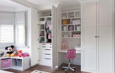White satin laquered floor to ceiling fitted wardrobes with plenty of storage