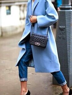 Blue Jeans, Blue Coat, White Shirt & Chanel make for a perfect outfit.