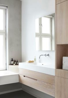 light wood + soft grey walls + simple bathroom