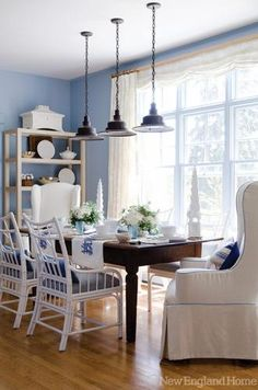 A Pretty Dining Area In Blue And White Is Clic Filled With