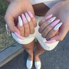 Light pink chrome nails with crystals, coffin nails