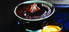 Coffee, chocolate, caramel, and peanut butter unite in these devilishly-good molten puddings.