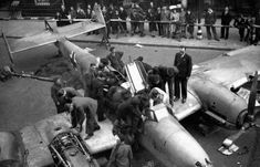 Downed Bf-110D being displayed for British soldiers and civilians in London, 1940.