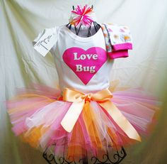 Valentine's Day Tutu LOVE BUG Heart Onesie Leg warmers and Headband Outfit Set Infant Baby Toddler Sizes. $55.00, via Etsy.
