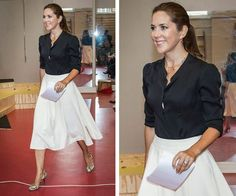 The Aussie-native who was recently [crowned the most fashionable royal]( http://www.womansday.com.au/royals/royal-style/princess-mary-most-fashionable-royal-13432), oozed sophistication in a chic silk black top, pleated cream midi-skirt, incredible round-toed snakeskin heels capped off with natural make-up and a sleek up-do ponytail.