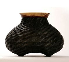 Black handwoven basket with wooden rim