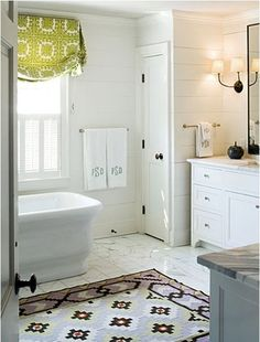 Next project: The Girls' bathroom - Emily A. Clark. Cute rug!