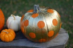 A can of gold spray paint and circle stickers make for a friendly pumpkin that's also a little bit glam.