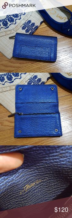 """3.1 Phillip Lim Metallic Cobalt Blue Wallet Pouch Excellent used condition wallet by 3.1 Phillip Lim. 100% leather. Textured and wrinkled leather has a shiny metallic finish in black and bright cobalt blue. Gunmetal pewter hardware. Outside rear pocket, 2 interior pockets, and one zippered pocket. Double snap closure. Use as a wallet- pouch for change and a few cards and cash. Can also use as a mini clutch if you want to nix the purse. Measures 5.5"""" long, 3.25"""" wide, and 1"""" thick. Outside…"""