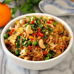 When we think of fried rice, we think Chinese food. This chicken & coriander fried rice, on the other hand, goes well with Indian curries.