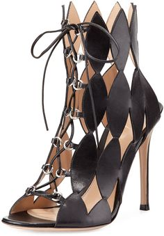 "GIANVITO ROSSI DIAMOND CUTOUT LACE-UP SANDAL, NERO $789 by Gianvito Rossi at Neiman Marcus Available Colors: NERO Available Sizes: 36.5B/6.5B,39.0B/9.0B DETAILS Gianvito Rossi calf leather sandal. 4 1/2"" covered stiletto heel. Diamond-shaped cutouts. Lace-up front; open toe. Leather lining and sole. Made in Italy."