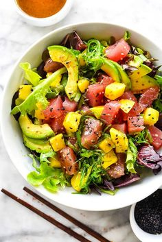 Hawaiian Ahi Tuna Poke and Mango Salad. A simple three ingredient dressing tops fresh ahi tuna, mango and avocado on a bed of spring mix in this flavorful Asian salad, perfect for lunch or dinner. Salmon Recipes, Seafood Recipes, Cooking Recipes, Fresh Tuna Recipes, Avocado Recipes, Cookbook Recipes, Best Salad Recipes, Healthy Recipes, Delicious Recipes