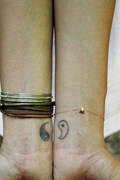 Yin Yang wrist tattoo. So cool! wouldn't mind this!