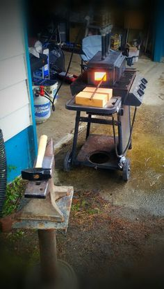 Beginner blacksmith! 100# Trenton anvil (late 1800's) welded to 1/8inch steel plate and welded to homemade stand. Majestic Forge Delux 3burner forge on top of and old bbq grill (for mobility). We all got to start somewhere :)