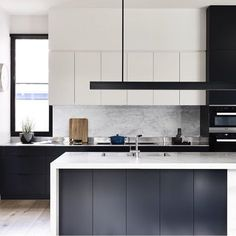 Little bit of monochrome kitchen love right here by @austin_design_associates at their Malvern Project Photo @derek_swalwell Linear Pendant Lights are my new addiction too... currently have @matbenett custom making one for our kitchen to be revealed shortly.. excited much x