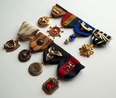 """All Things Crafty: DIY """"Upcycled"""" Costume Medals used costume jewelry pendants, etc. with ribbon. permanent marker to """"color"""" ribbon"""