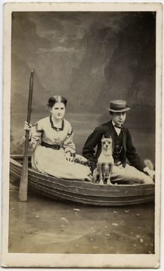 Couple in boat with small dog.