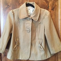 Beige Tulle cropped pea coat **lowest price**. Three button front closure - two buttons and one snap. Cute pocket detail. Great for the transitional months. Pretty geometric print lining. Fully lined. Half sleeve length Tulle Jackets & Coats Pea Coats
