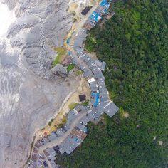 This gauntlet of market shops divides the crater from the forrest at Kawah Ratu Tangkuban Perahu volcano near Lembang Java Indonesia  #volcano #travel #indonesia #wanderlust #jakarta #dji #drone #djivision #dronegear #droneventures #fly #aerial #aerialphotography #phantom2 by phantom_hawk2
