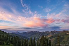 Sunrise colors clouds above the Slate River Valley and Ruby Range mountains as seen from Paradise Divide, Colorado