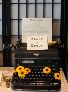 Yellow and gray vintage wedding with typewriter with the programs of the wedding