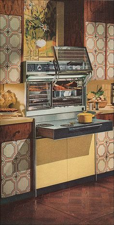1966 Frigidaire Flair Range in Harvest Gold  - love it all, especially those crazy cabinets!