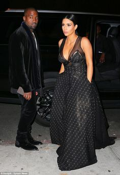 Looking good: Kim's raven-coloured locks were pulled back in an elegant ponytail featuring...