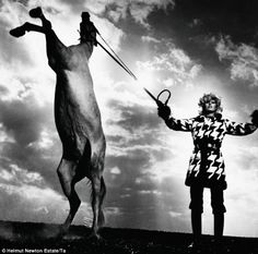Helmut Newtown - glamorous model pulling on a horse's reins from French Vogue in 1969