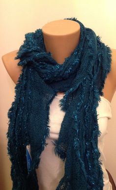 A personal favorite from my Etsy shop https://www.etsy.com/listing/226718363/50saledark-green-knitted-scarffringed