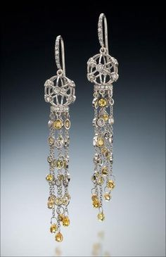 Drop Earrings by Christopher Duquet.    Material: 14K white gold, round brilliant diamonds, round brilliant sapphires.      Photographer: Ralph Gabriner